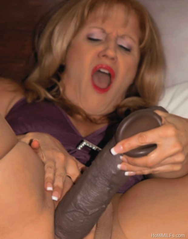 Hot MILF Bangs Her Pussy With A Thick Black Dildo Cock